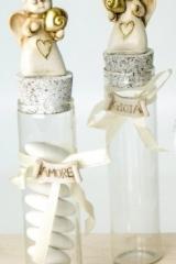 Provetta vetro con angelo resina e fiocco applicato. Ass 2. H 18  Codice- E049589