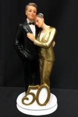 Cake topper coppia 50° in resina con abito glitter oro. H 18.5  Codice- PB14521